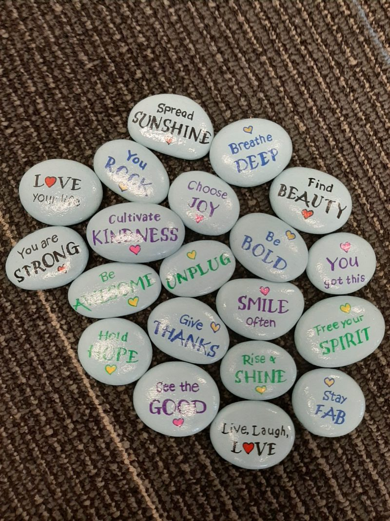 Dawn painted wellbeing rocks